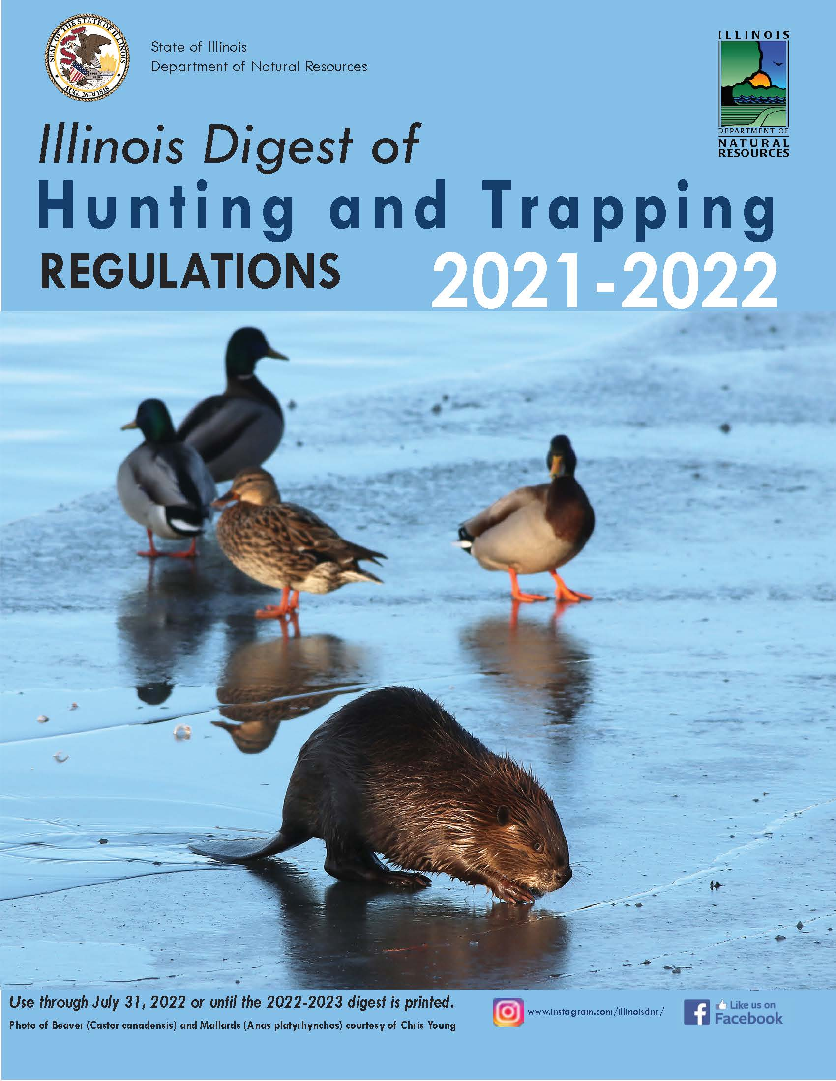 The cover of the new Illinois Digest of Hunting and Trapping Regulations for 2021–2022. The photo on the cover is a frozen wetland with a group of mallard ducks and a beaver on top of the ice.